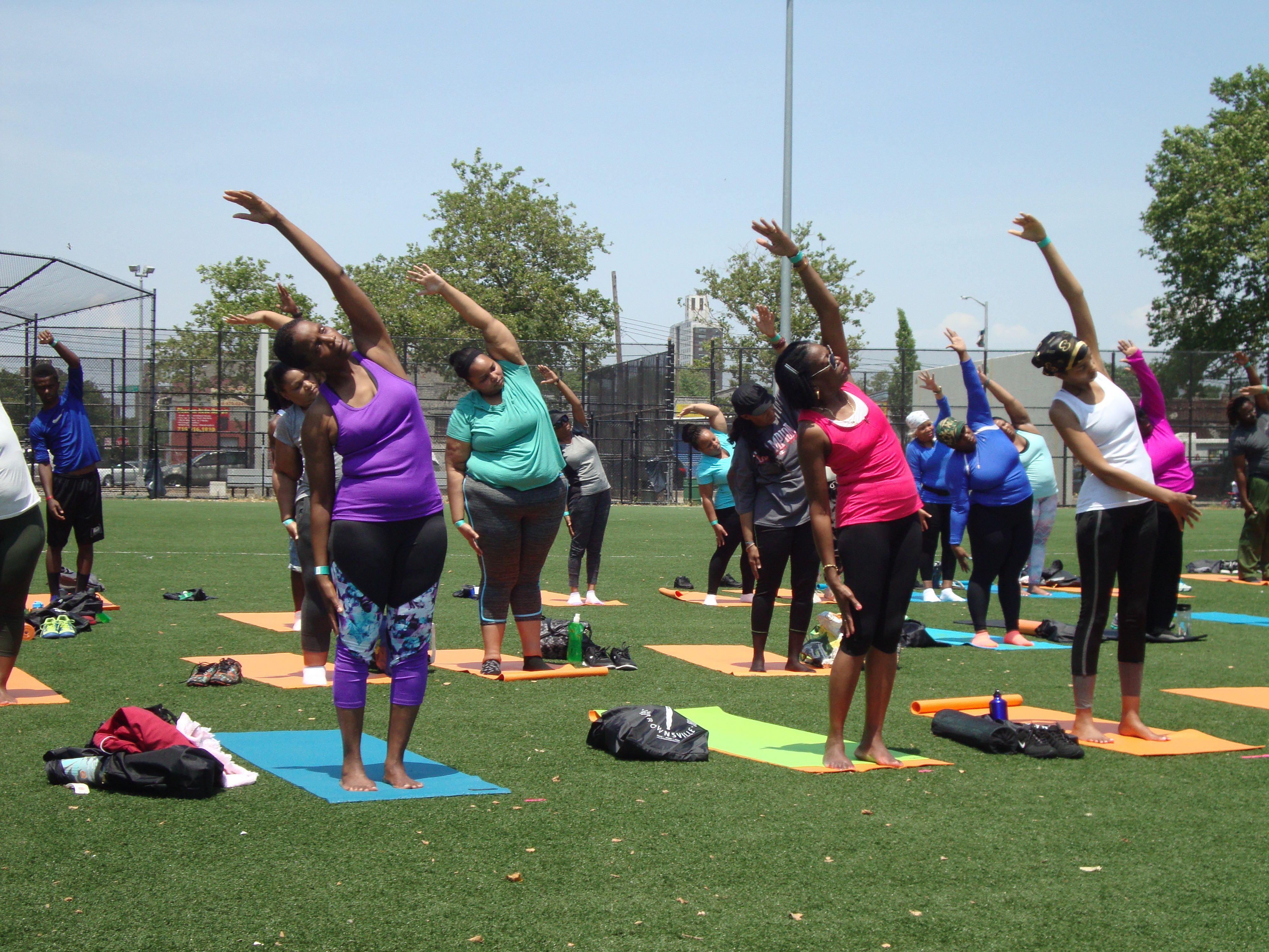 Alternate side stretch - Breathe Brownsville Brooklyn Yoga Festival