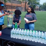 Water bottle table for yogis to stay hydrated - Breathe Brownsville Brooklyn Yoga Festival