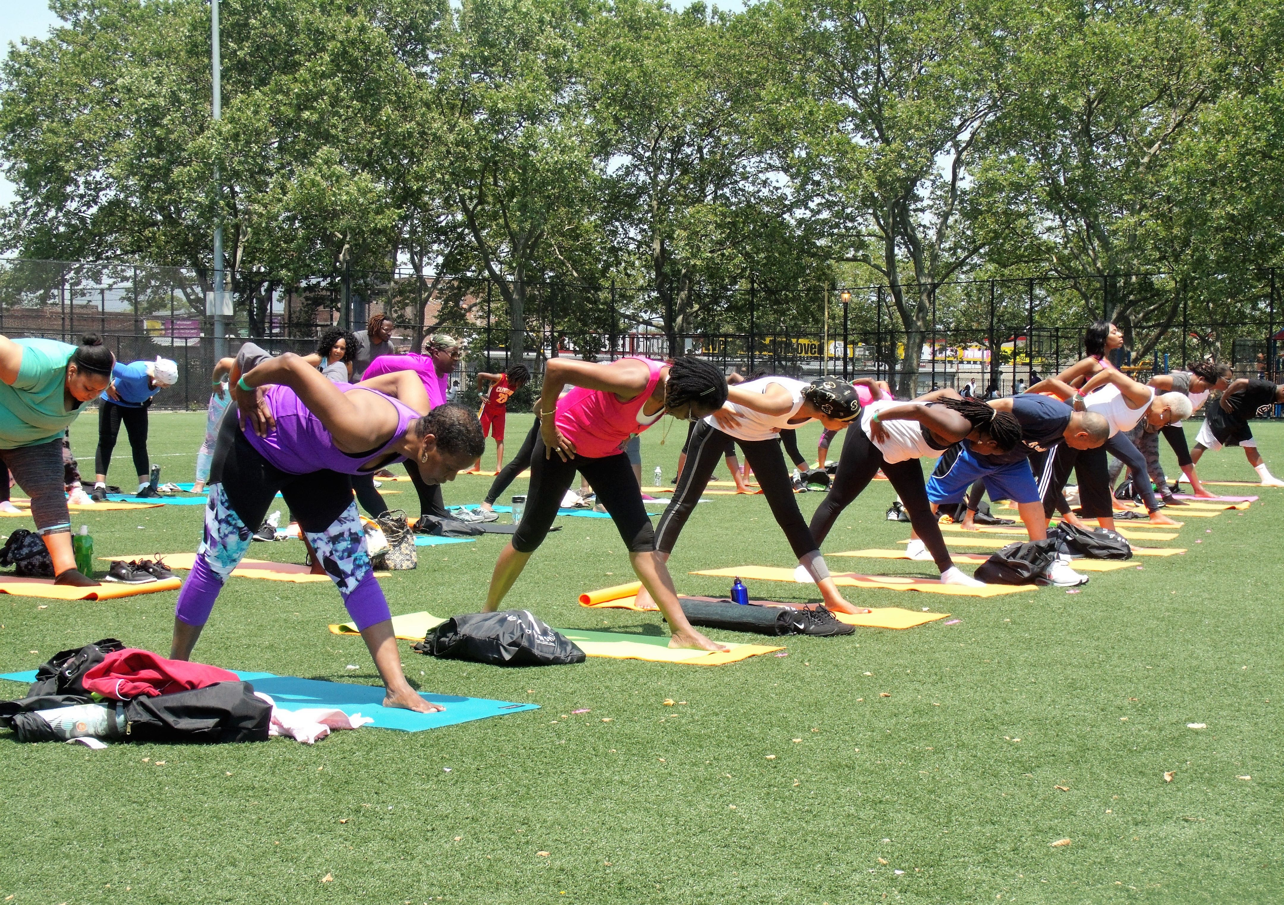 Exhaling forward into Parvottanasana pose - Breathe Brownsville Brooklyn Yoga Festival